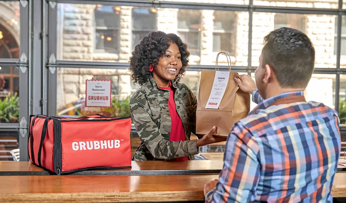 Grubhub delivery person receiving order