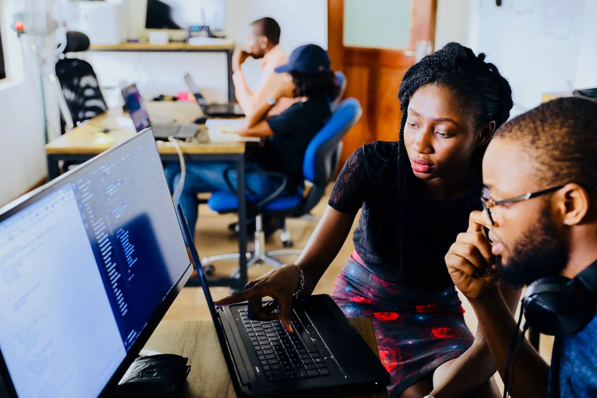 Black business owners looking at computer
