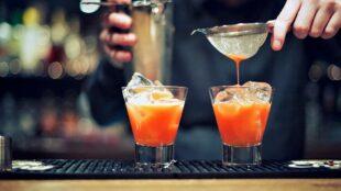 Bartender mixing drinks